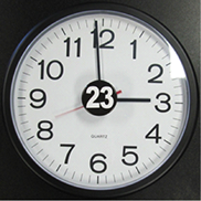 A clock with a 23-hour awareness button in the center of the dial.